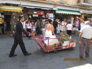 Bride and groom playing in the shuk